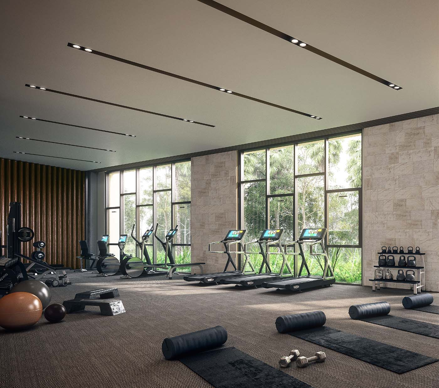 Gym area of a retirement village with floor mats and exercise machines.