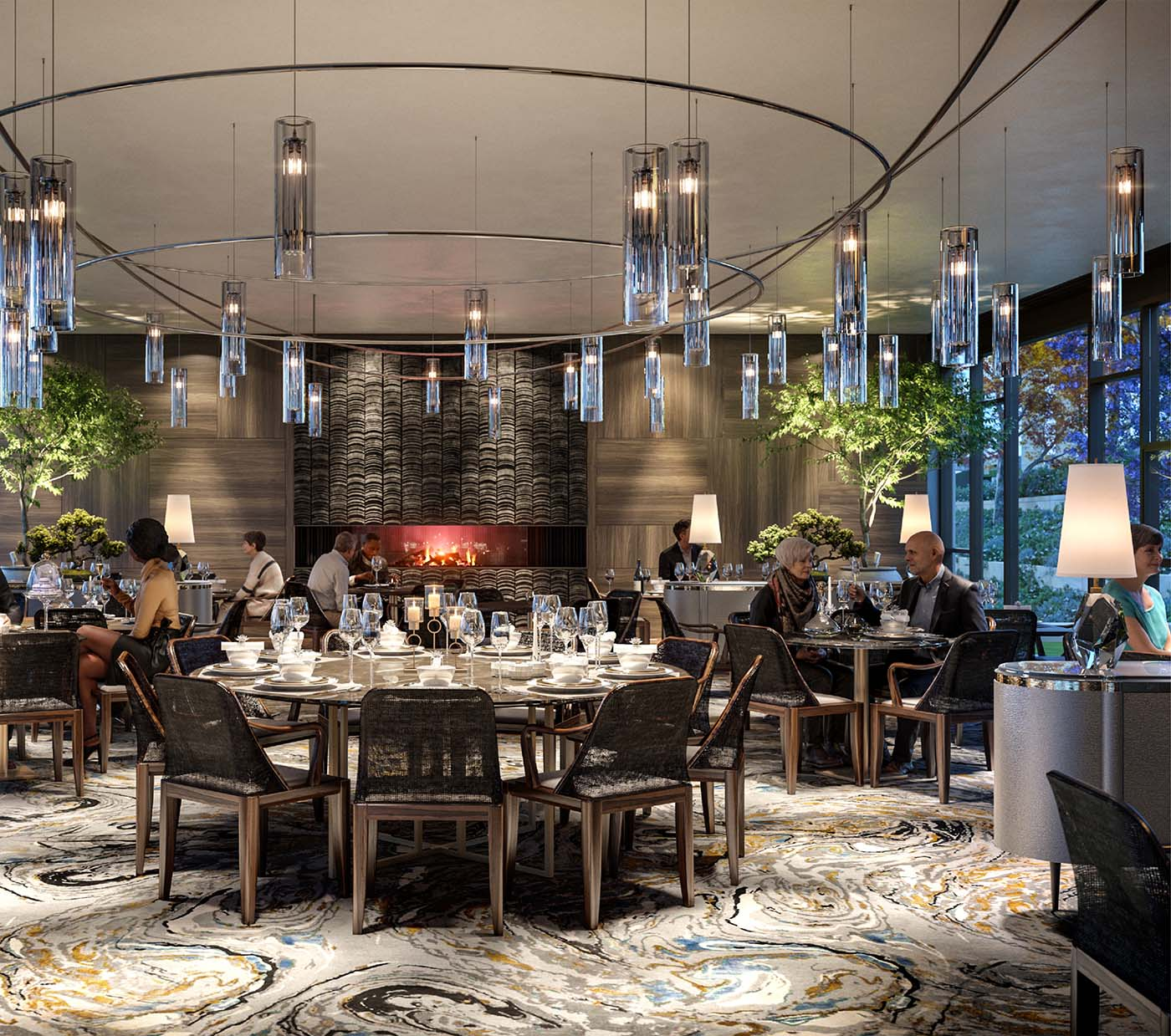 Restaurant area of a retirement village with people talking and eating surrounded by a firepit, elegant lamps and artistic rug.