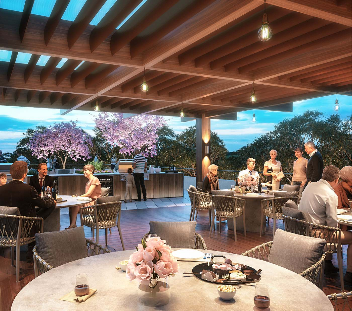 Terrace and dining area of a retirement village with people talking and eating.