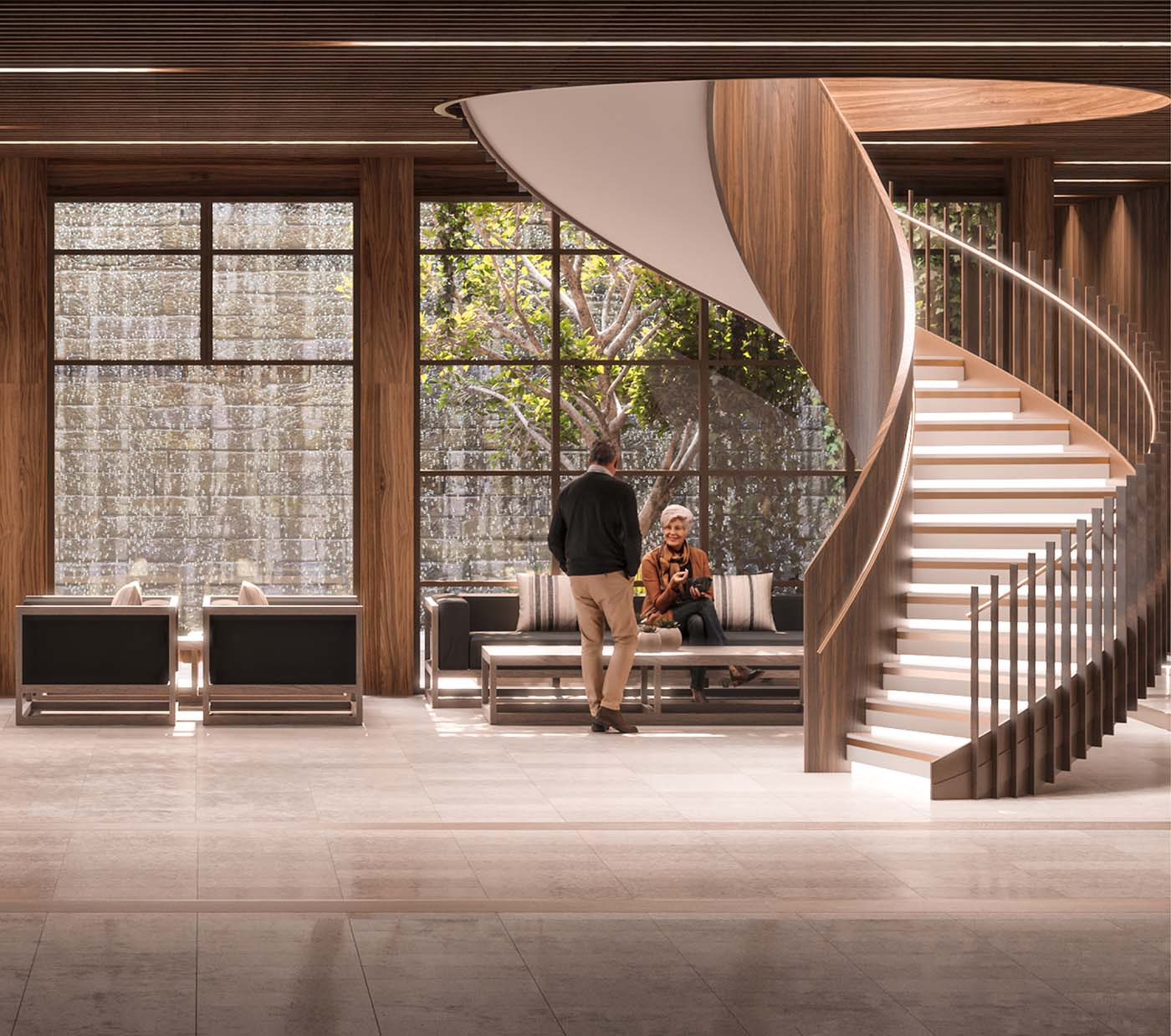 Wellness foyer of a retirement village with people sitting and talking near a spiral staircase.