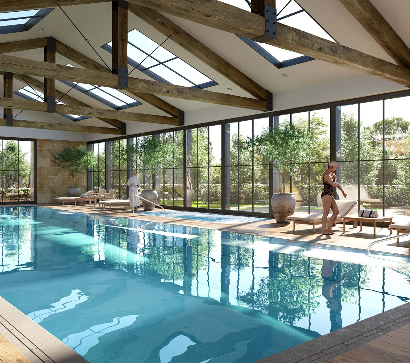 Swimming pool area of a retirement village with glass walls and woman going out of the pool.