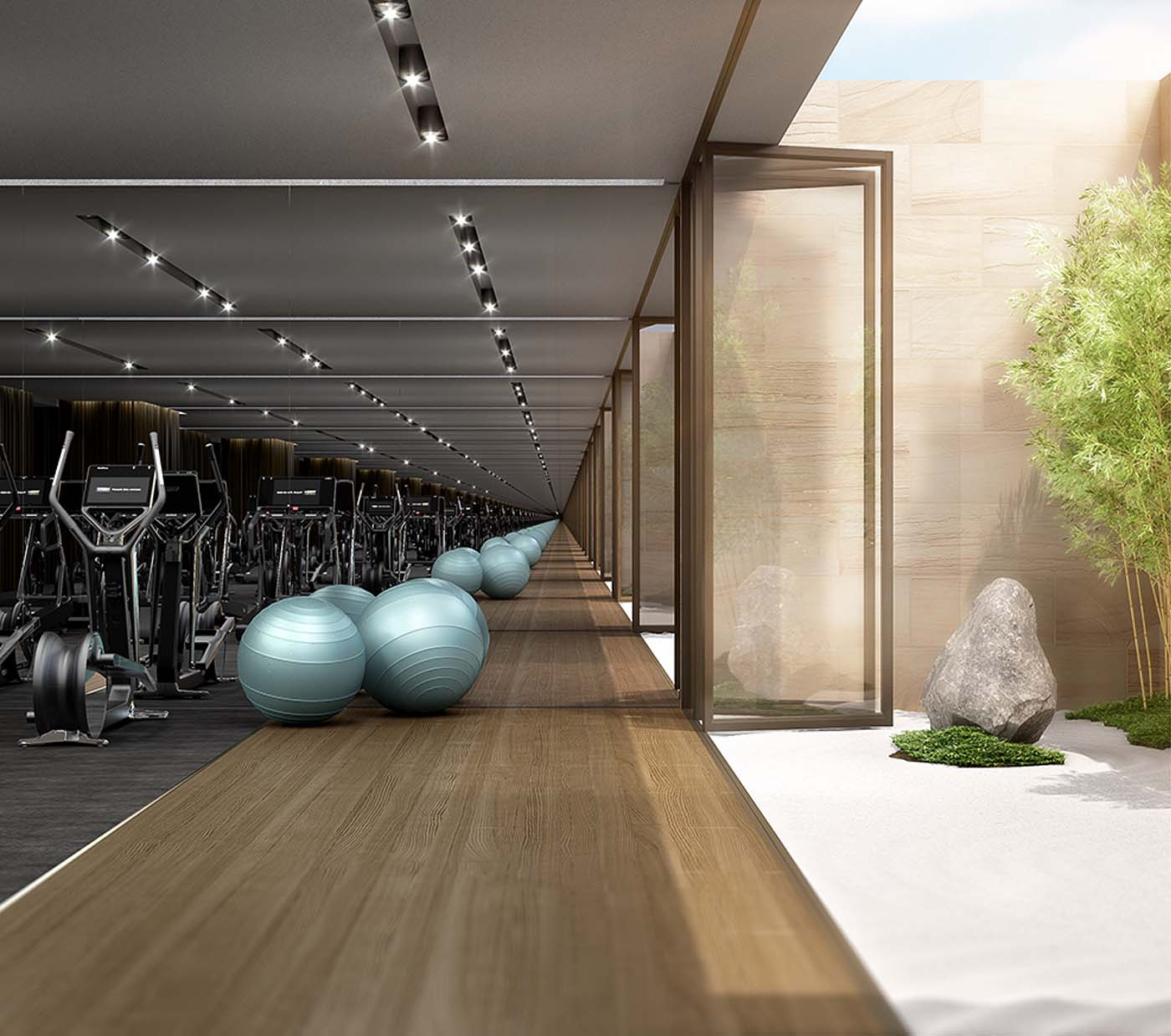 Gym area in a skyscraper showing exercise balls and fitness machines.