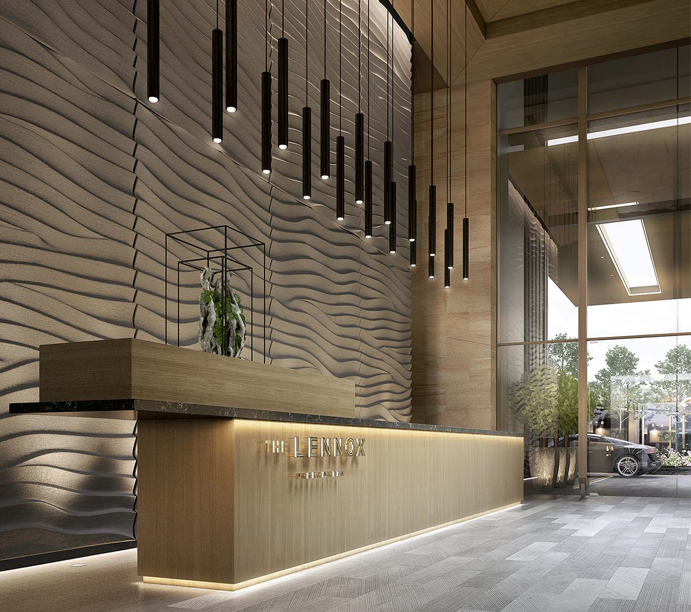 Lobby area of a skyscraper showing reception and lamps.