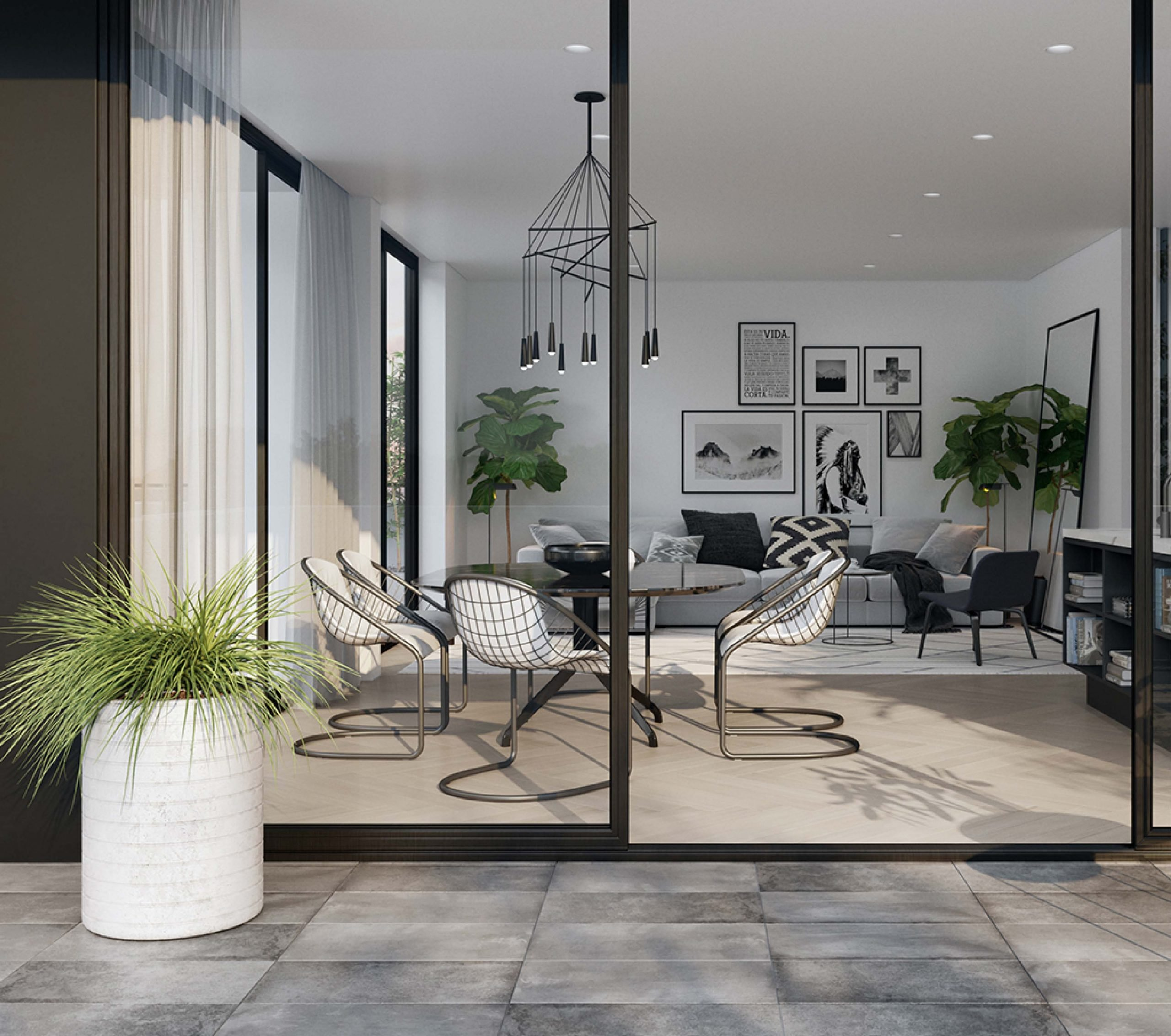 living room with black and white palette and painting on the wall