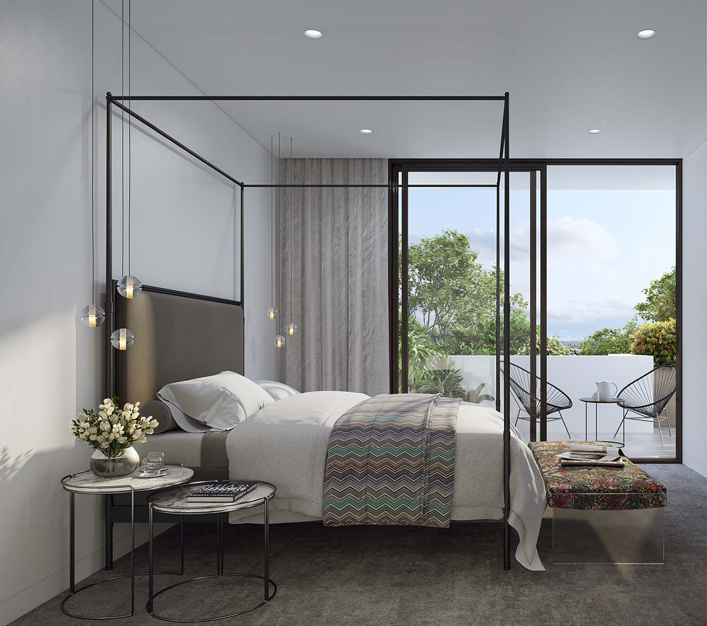 bedroom with four-poster bed and a balcony