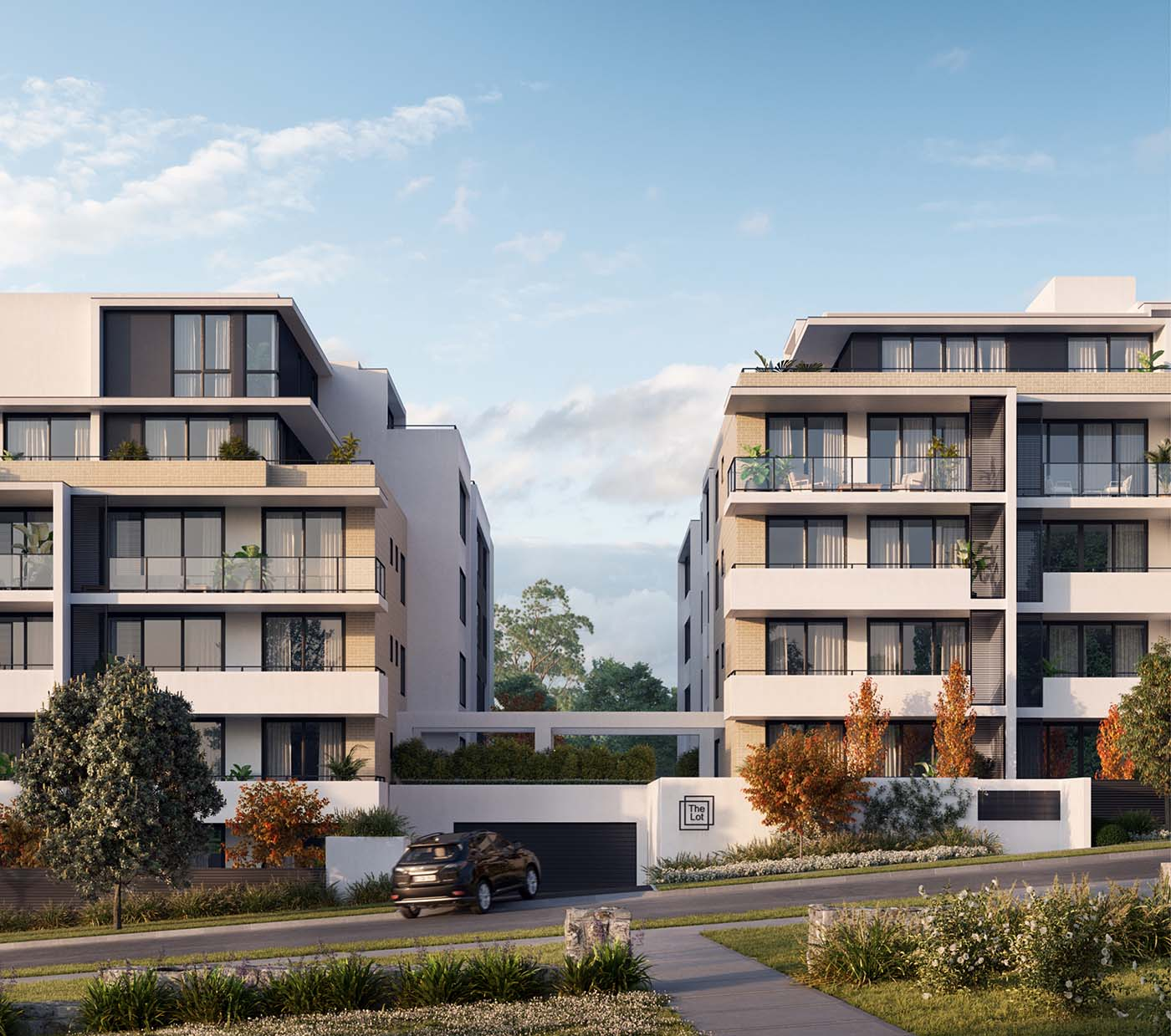 Residential apartments outdoor view with car entering in the parking