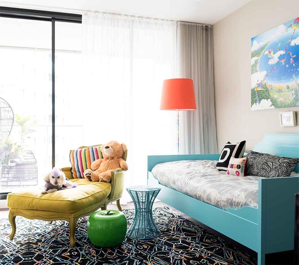 Kids bedroom with acquamarine bedfrae and yellow sofa