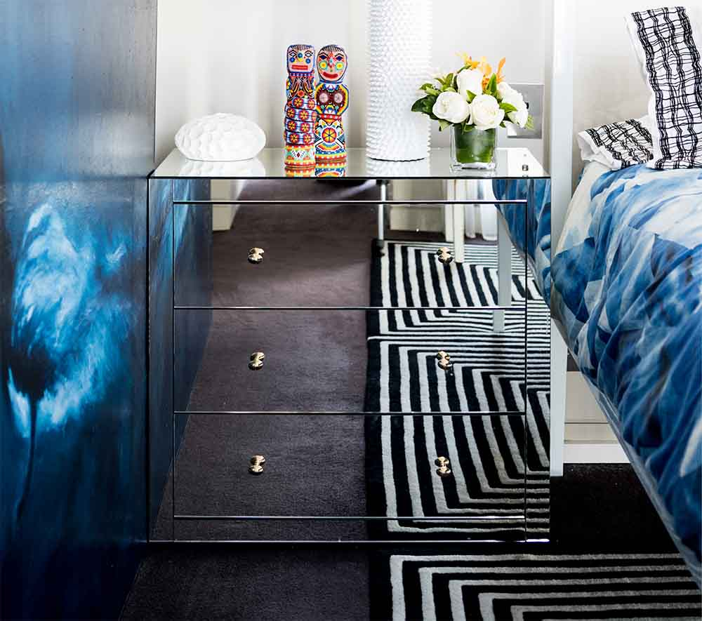 Bedside table made of mirrored glass