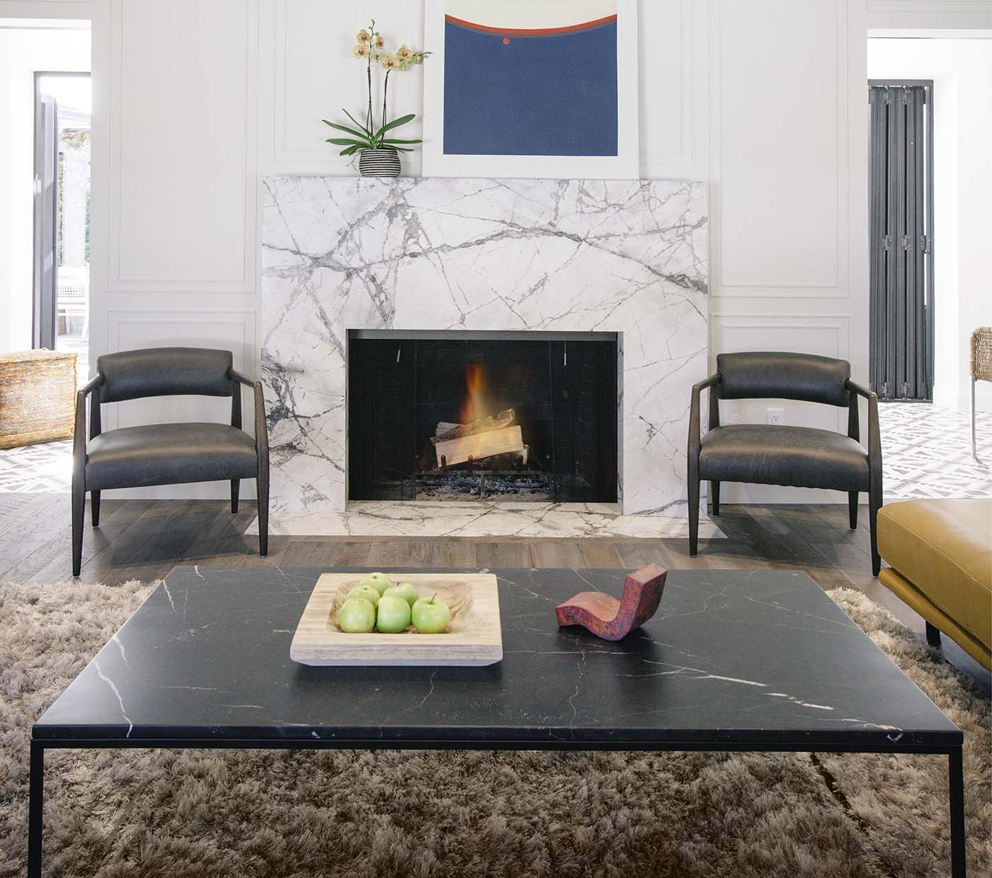 Living room with firepit, chairs and black table